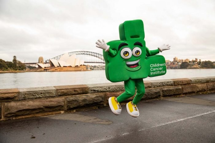 CEO Dare To Cure mascot in front of Sydney Opera House and Harbour bridge