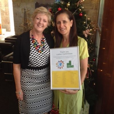 ladies committee holding thank you certificate